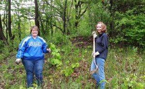 Stephanie and Teresa planting trees web