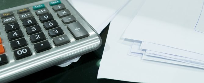 A photo of a calculator and papers
